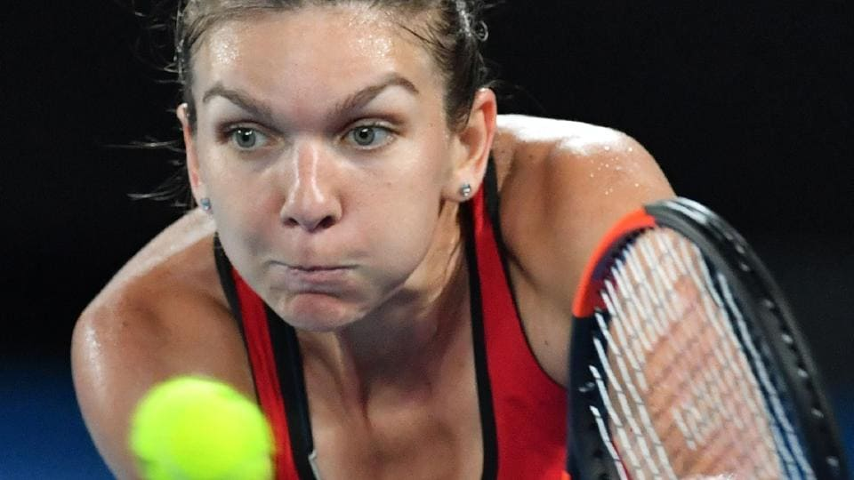 Simona Halep brought out her A game during the Australian Open final against Caroline Wozniacki, who prevailed in the marathon match.  (AFP)