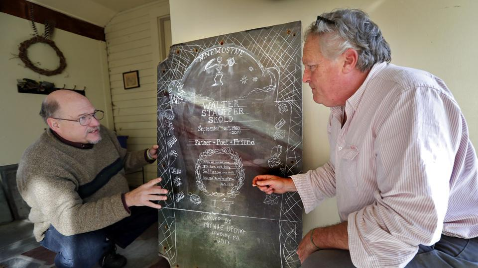 Walter Skold (left) and gravestone carver Michael Updike discuss the design of Skold's future tombstone.