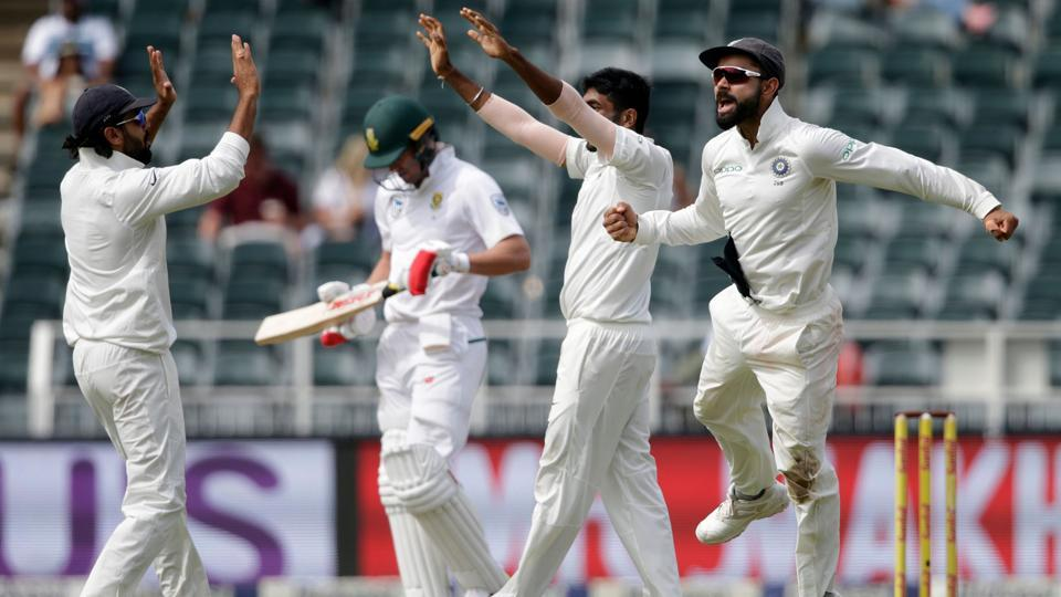 Virat Kohli (R) and his Indian cricket teammates celebrate after winning the third Test against in Johannesburg.