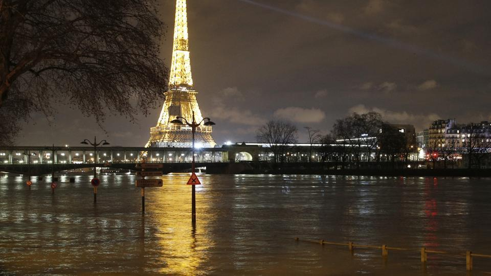 Floodwaters are nearing their peak in Paris, with the rain-swollen Seine river engulfing scenic quays and threatening wine cellars and museum basements.