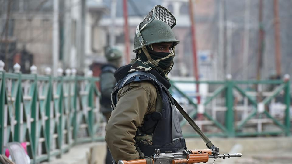 A paramilitary trooper stands guard in Srinagar on January 25, 2018.
