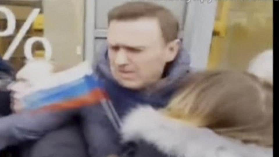 A still image taken from a video footage shows Russian opposition leader Alexei Navalny being detained by interior ministry members during a rally for a boycott of a March 18 presidential election in Moscow, Russia.