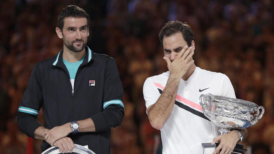 Roger Federer, right, wipes tears from his eyes after defeating Marin Cilic, left, in the men's singles final at the Australian Open.