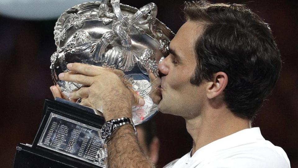 Switzerland's Roger Federer kisses his trophy after defeating Croatia's Marin Cilic during the men's singles final at the Australian Open tennis championships in Melbourne on Sunday.