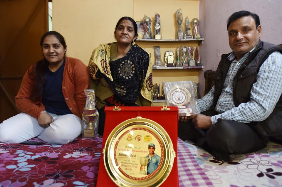 Parents of cricketer Shivam Mavi at his residence Sector 71.