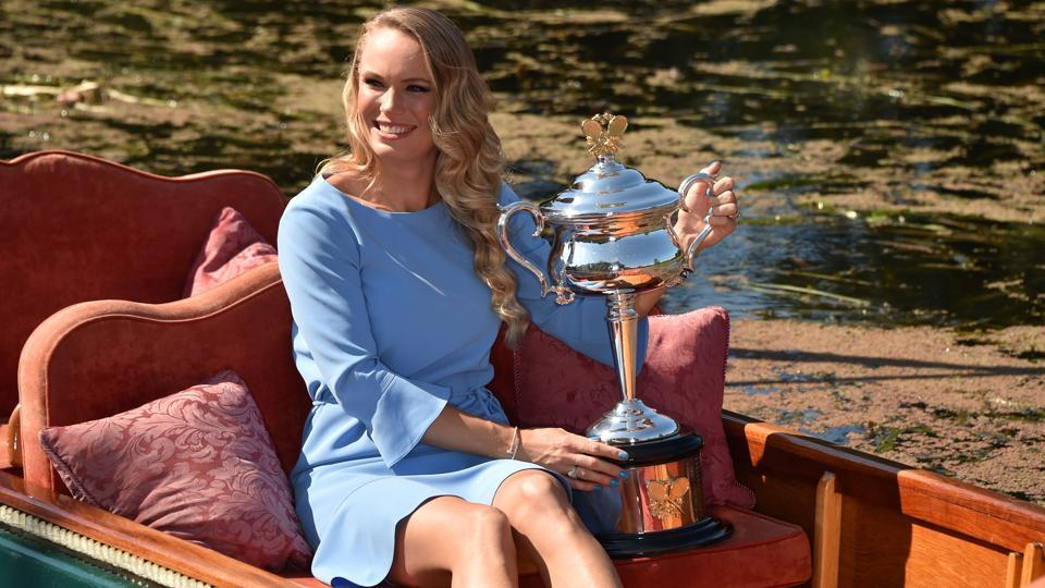 Denmark's Caroline Wozniacki arrives in a gondola with the winner's trophy for a photocall at the Royal Botanical Gardens in Melbourne on Sunday, a day after beating Romania's Simona Halep in their women's singles final at the Australian Open tennis tournament.