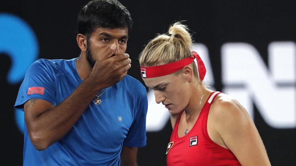 Hungary's Timea Babos (R) and partner Rohan Bopanna of India talk tactics against Canada's Gabriela Dabrowski and Croatia's Mate Pavic in the mixed doubles final of the Australian Open tennis championships in Melbourne on Sunday.