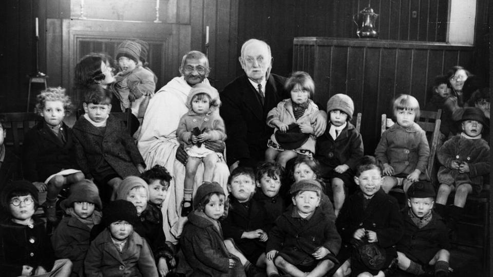 Gandhi with George Lansbury and some children at Kingsley Hall in London while attending the 1931 Round Table Conference. Returning to India in 1915, Gandhi delved length and breadth into its issues and adapted his lessons from South Africa to the local context. The years that followed were the making of the Mahatma and the Non-cooperation Movement, the declaration of Swaraj and the Dandi March saw him emerge a leader. (Hulton Archive / Getty Images)