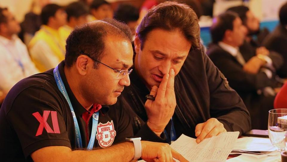 Virender Sehwag (L) and Ness Wadia in deep discussion during day 2 of the Indian Premier League (IPL) auction in Bangalore on the 27th January 2018.