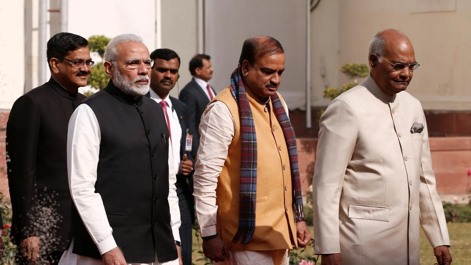 Prime Minister Narendra Modi and President Ram Nath Kovind alk inside the parliament premises as they arrive to attend the first day of the budget session in New Delhi.