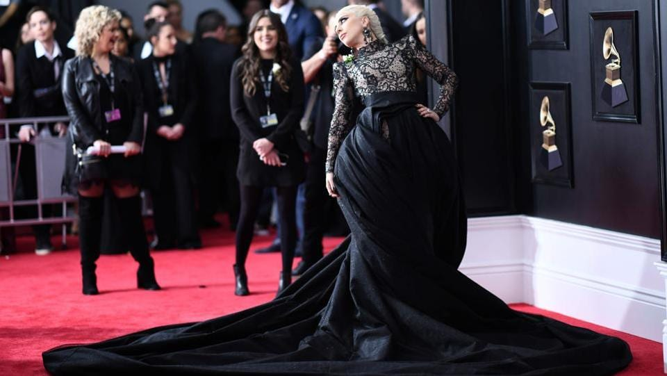 Lady Gaga arrived in a lace cat suit with a statement skirt by Armani Prive. Her long platinum hair was swept back in a fishtail braid. The look earned her praise all around on a carpet that wasn't quite as star-studded as usual. (Jewel Samad / AFP)