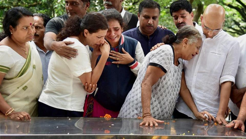Journalist Gauri Lankesh 's mother Indira, brother Indrajit Lankesh and sister Kavitha Lankesh grieve near the mortal remains of her, in Bengaluru on Wednesday, Sept. 6, 2017.