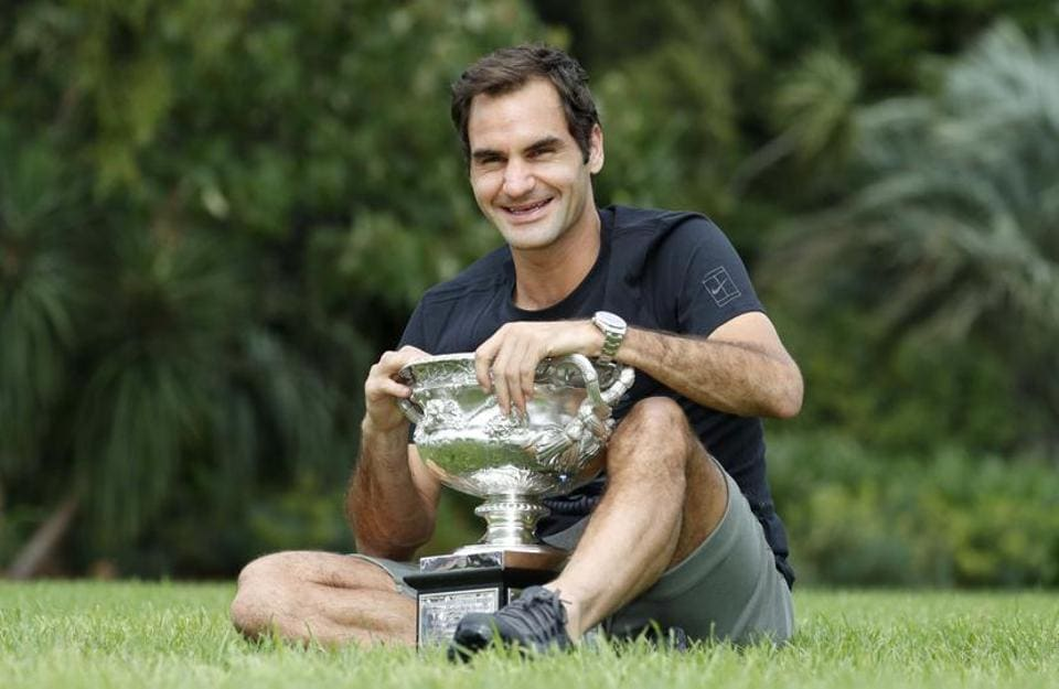 Roger Federer of Switzerland poses with the men's singles trophy during the winner's photoshoot at the government house in Melbourne on Monday.