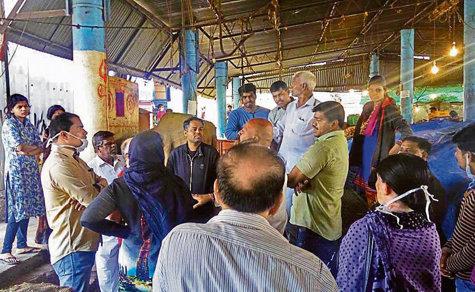 Members of Janwani, a NGO working towards solid waste management, explained to the stall owners at the vegetable market the need to keep their vicinity clean.