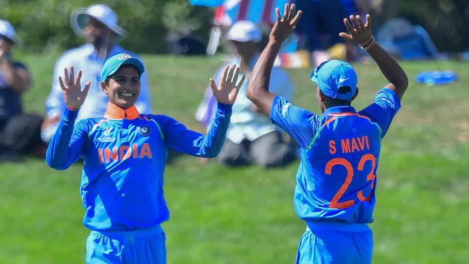 India's Shubman Gill (L) celebrates catching Pakistan's Hassan Khan with teammate Shivam Mavi during the ICC U19 World Cup semi-final between India and Pakistan at Hagley Oval in Christchurch on January 30, 2018.