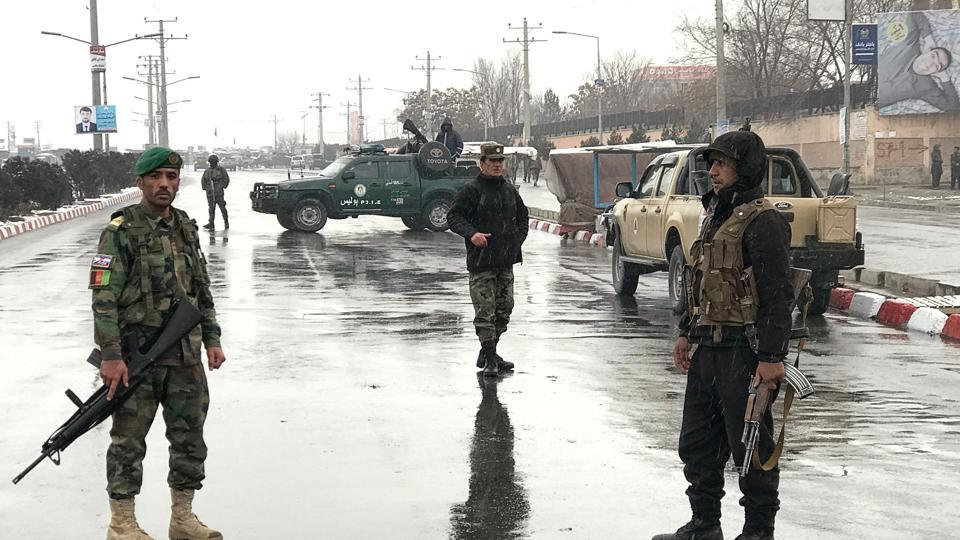 Afghan security forces stand near the Marshal Fahim military academy after a series of explosions in Kabul, Afghanistan January 29, 2018.