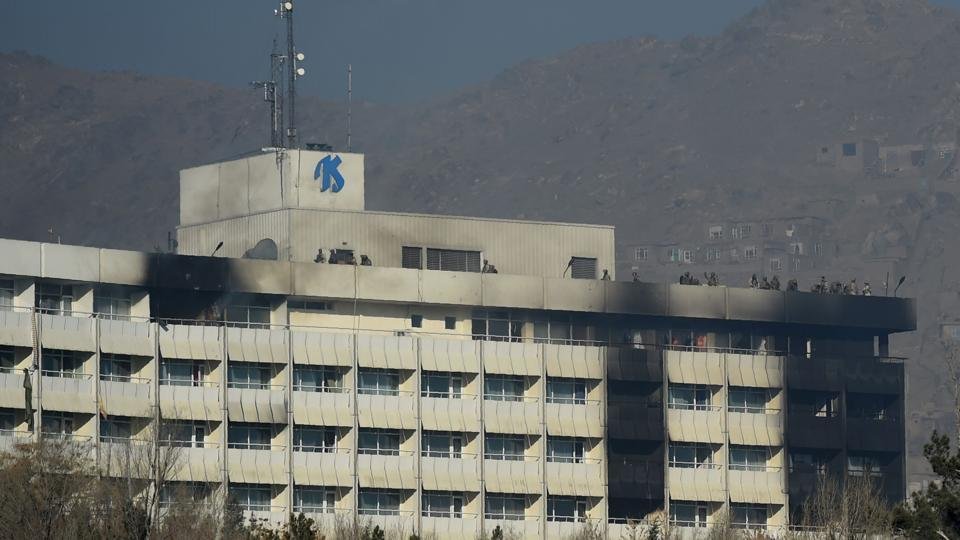This file photo taken on January 21 shows Afghan security personnel take position at the rooftop of the Intercontinental Hotel during a fight between gunmen and Afghan security forces in Kabul. At least 40 people were killed in the attack on Kabul's luxury Intercontinental Hotel at the weekend, official figures showed on January 25 -- almost double the earlier toll released by Afghan authorities.