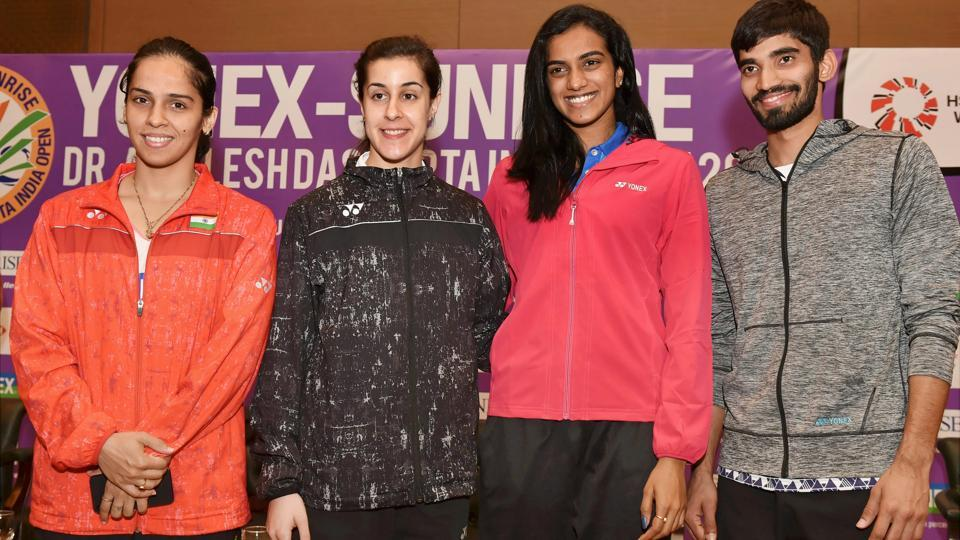 Saina Nehwal, PV Sindhu, Kidambi Srikanth and Spanish shuttler Carolina Marin pose for a photograph during a press conference of India Open badminton tournament in New Delhi on Tuesday.