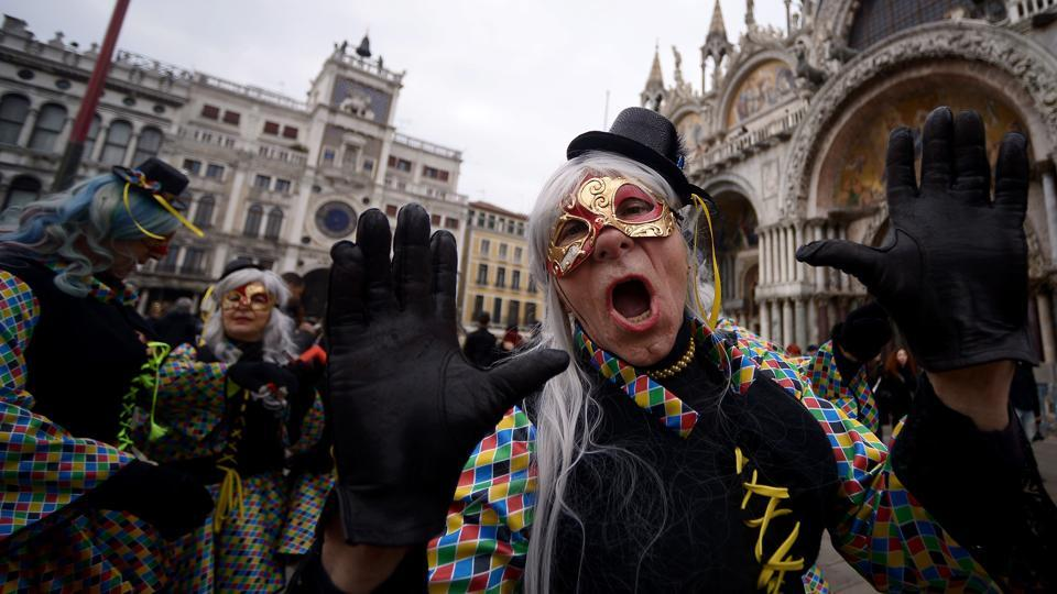 Mayor Luigi Brugnaro has gone so far as to encourage visitors to head out the city's suburbs to ease overcrowding, and promote celebrations on the mainland. (Filippo Monteforte / AFP)
