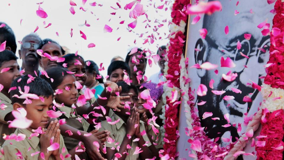Schoolchildren pay homage to a portrait of Mahatma Gandhi on his 70th death anniversary, in Chennai on Tuesday.