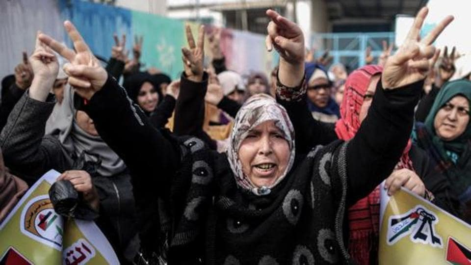 Palestinian women protest outside of the United Nations' offices in al-Nusirat refugee camp in the Gaza strip on January 17, 2018 after the White House froze tens of millions of dollars in contributions.