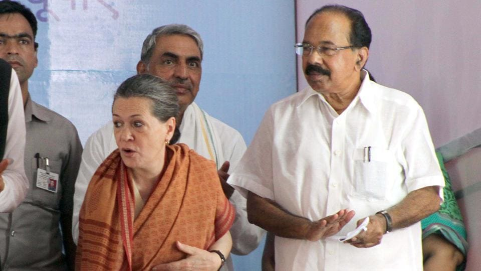 Sonia Gandhi with Congress leader M Veerappa Moily in Barmer last February.