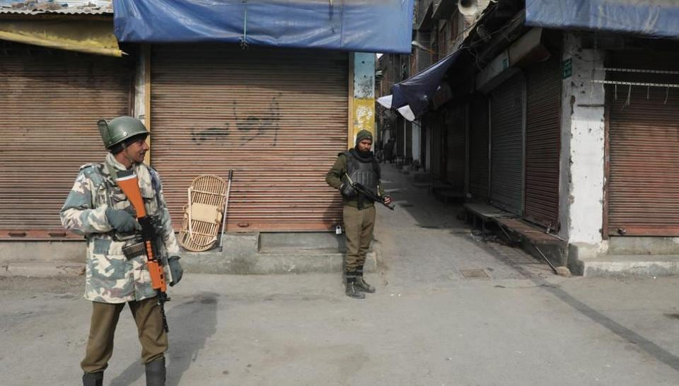 Paramilitary soldiers stand guard during restrictions in downtown area of Srinagar, India, January 28, 2018.
