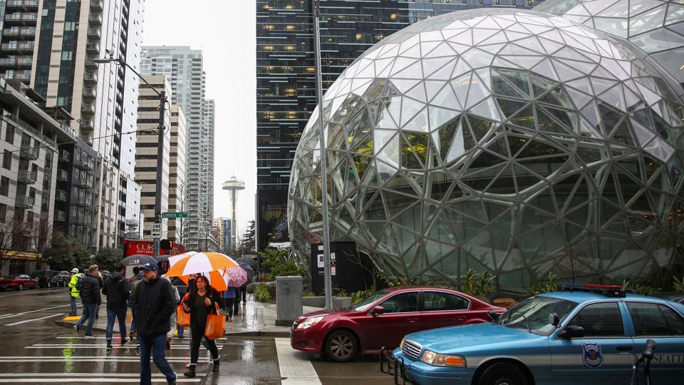 The Amazon Spheres are seen from Lenora Street, with the Space Needle in the background. Critics have called the Spheres a vanity project, illustrating Seattle's sometimes strained relationship with its largest employer. (Lindsey Wasson / REUTERS)