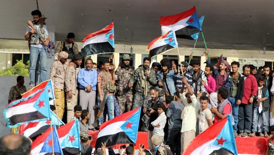 Supporters of southern Yemeni separatists take part in an anti-government protest in Aden, Yemen, on Sunday.