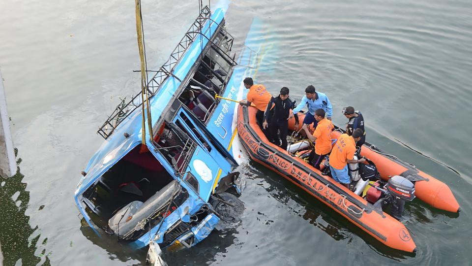 The bus which fell into Ghogra Canal in Murshidabad on Monday being pulled out.