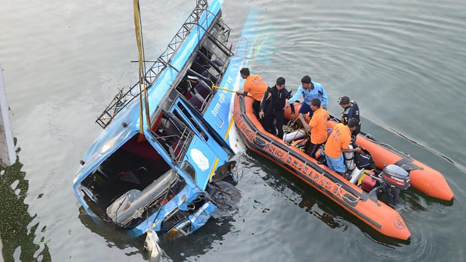 The death toll in the bus accident in Behrampore in Bengal rose to 42 on Tuesday with rescuers retrieving six more bodies from the canal where the vehicle plunged Monday morning. Locals suspect about 10-12 bodies could still be trapped in the mud. (AFP)