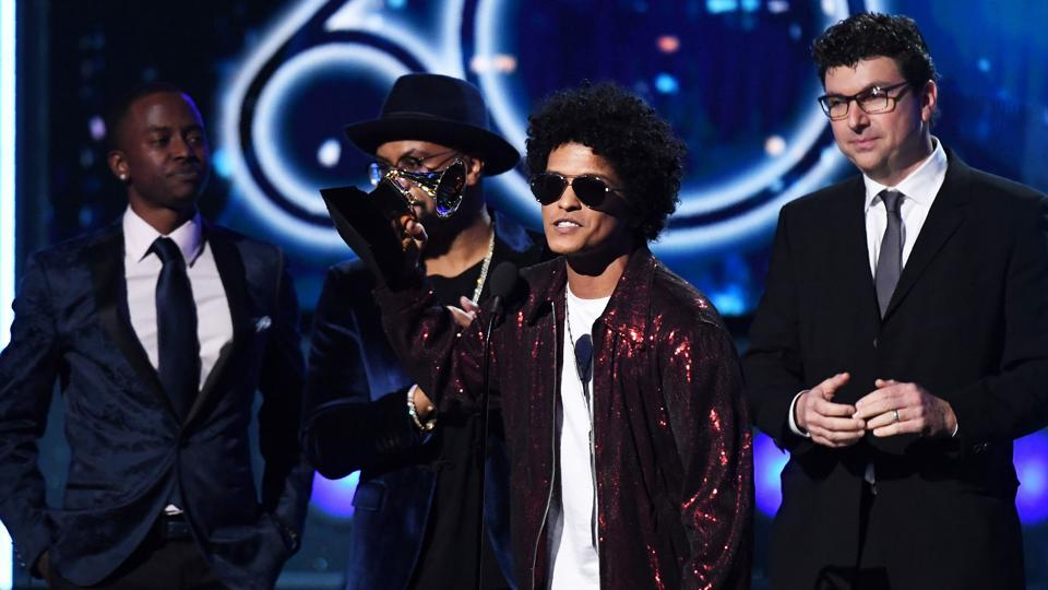Bruno Mars receives a second Grammy for Record of the Year during the 60th Annual Grammy Awards show on January 28, 2018, in New York.