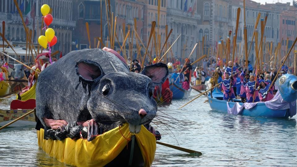 According to tradition, the carnival begins with 'the Flight of the Rat', when a giant model rat leads decorated boats in the opening regatta as it sails down the Grand Canal. (Manuel Silvestri / REUTERS)