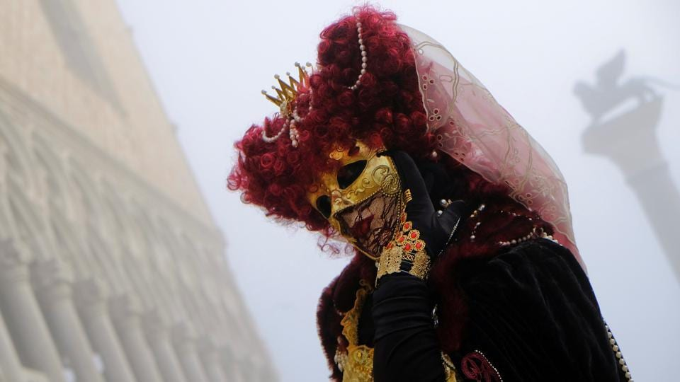 The Venice carnival is believed to have started in 1162, when Venetians spontaneously gathered in Saint Mark's Square to celebrate a military victory of the Venetian Republic. (Manuel Silvestri / REUTERS)