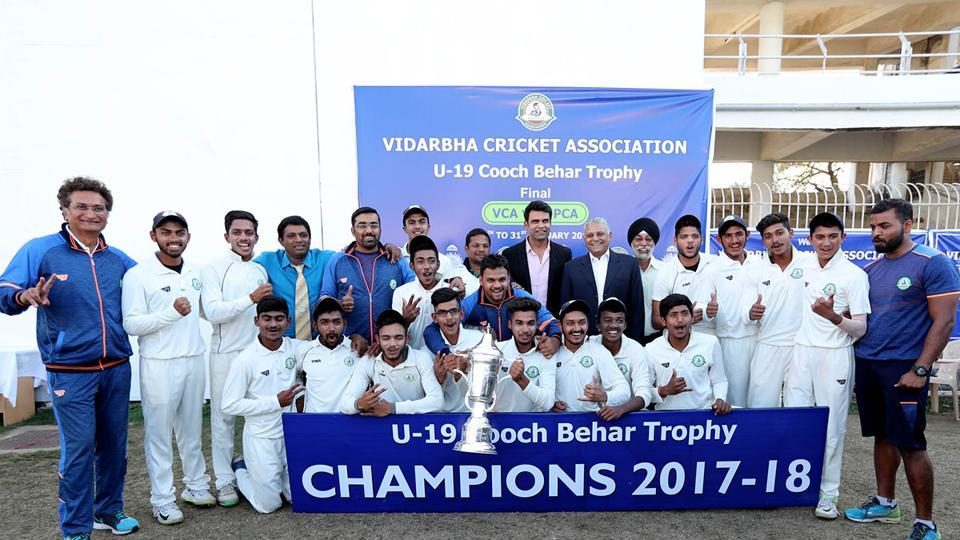 The victorious Vidarbha team with the U-19 Cooch Behar cricket trophy.