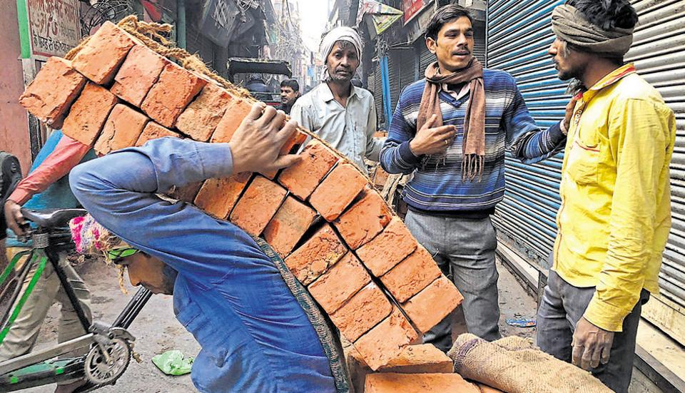 Labourers at work at a city bazar.