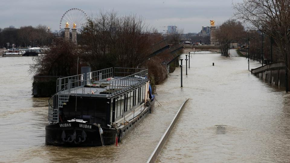 "Police has warned people against bathing or canoeing in the swollen river, saying it was ""forbidden and extremely dangerous"". Even once the water levels start to recede officials say it will be a slow process, as much of the ground in northern France is already waterlogged. (Gonzalo Fuentes / REUTERS)"