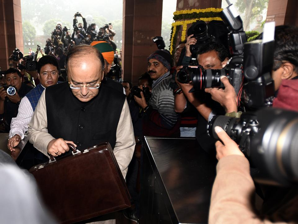 File photo of finance minister Arun Jaitley with Budget papers outside the Parliament House last year.