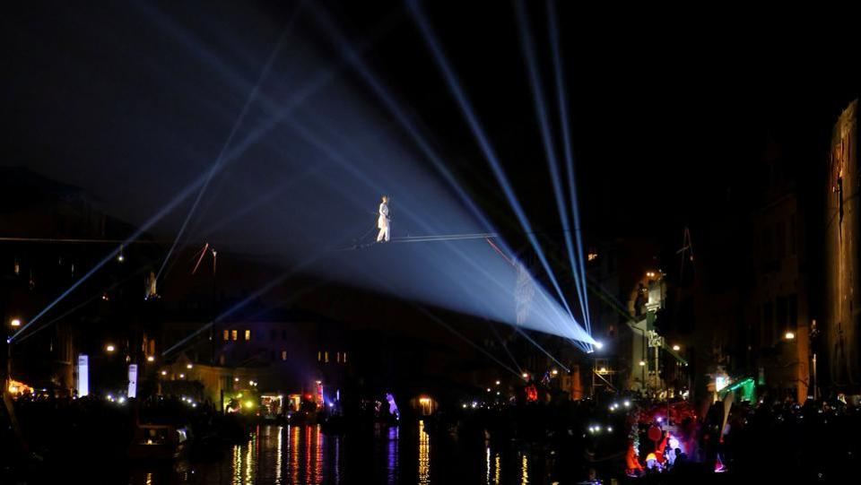 Cannaregio Channel is illuminated as a tightrope walker performs during the opening ceremony of the Carnival in Venice. The theme for this year's carnival is 'Creatum: Civitas Ludens', Latin for 'Creativity: City of Sport'. (Manuel Silvestri / REUTERS)