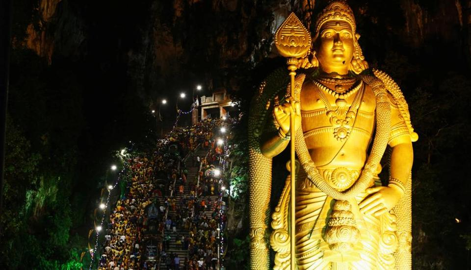Devotees climb the steps to Batu Caves during the Thaipusam festival in Kuala Lumpur, Malaysia. Thaipusam marks the day when the goddess Parvathi gave her son Murugan a powerful lance to fight demons. It is observed mainly in countries with a significant ethnic Tamil population. (Lai Seng Sin / REUTERS)