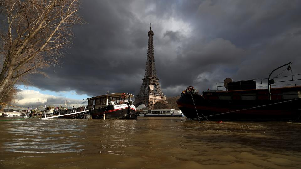 Peniche houseboats seen moored by the Eiffel Tower, along the flooded River Seine after days of non-stop rain in France. Floodwaters peaked in Paris on Monday and were threatening towns downstream as the rain-engorged Seine River winds through Normandy toward the English Channel. France's heaviest rains in 50 years have engulfed romantic quays in Paris, swallowed up gardens and roads and halted riverboat cruises. (Gonzalo Fuentes / REUTERS)