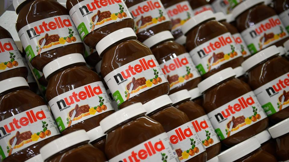 This photo taken on January 30, 2018 in Saint-Gregoire, near Rennes, northwest France, shows containers of Nutella. An independent organisation of the French economic ministry will launch an investigation on the recent 70%-off promotion of the Nutella spread, which sparked melees and brawls in several French supermarkets, learned on January 30.
