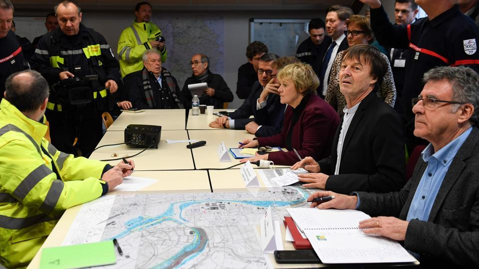 French Minister for the Ecological and Inclusive Transition, Nicolas Hulot (2R) and mayor of Champagne-sur-Seine, Michel Gonord (R) take part in a meeting at the fire station of Champagne-sur-Seine, Paris during an assessment visit on the Seine's rise. (Eric Feferberg / AFP)