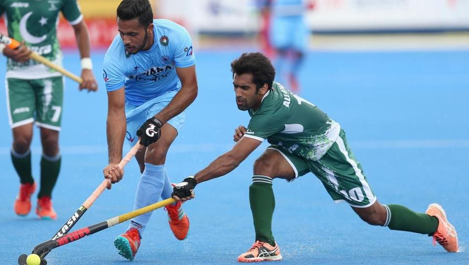 Harmanpreet Singh of India and Ali Shan of Pakistan battle for possession during the 5th-8th place match of the Hockey World League semifinal at Lee Valley Hockey and Tennis Centre on June 24, 2017 in London. India and Pakistan will clash in the Asian Champions Trophy hockey 2018 to be played in Muscat, Oman between October 18 and 28.