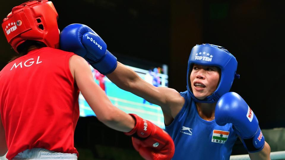 MC Mary Kom (right) jabs and scores agaisnt Altansetseg Lutsaikhan of Mongolia during their semifinal bout at the India Open International Boxing tournament in New Delhi on Wednesday.