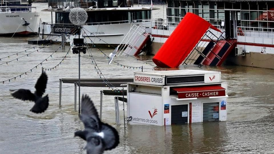 "A ticket booth for sightseeing boats is partly submerged by the River Seine. The water levels are expected to stay high for days or weeks spelling bad news for tourists hoping to cruise past Parisian sites on the famed ""bateaux mouches"" riverboats, or visit the bottom floor of the Louvre Museum, closed since last week as a precaution. (Mal Langsdon / REUTERS)"