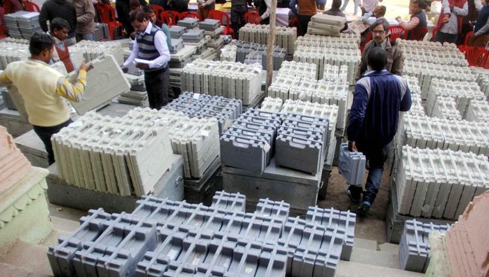 Polling officers collect electronic voting machines(EVM) and polling materials before leaving for polling booths in Uttar Pradesh.