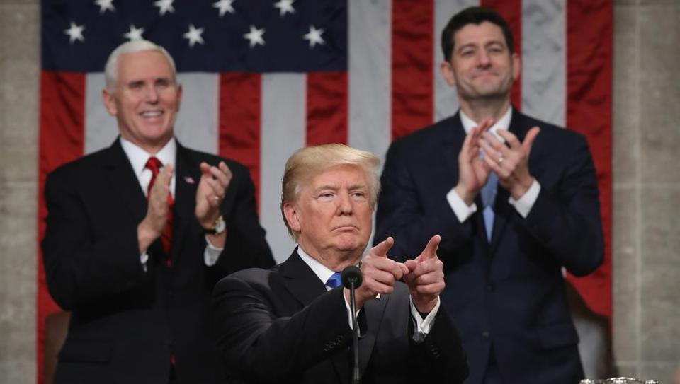 US President Donald J Trump delivering the State of the Union address as US vice president Mike Pence (left) and Speaker of the House Paul Ryan (right) look on in the chamber of the US House of Representatives on January 30, 2018 in Washington, DC.
