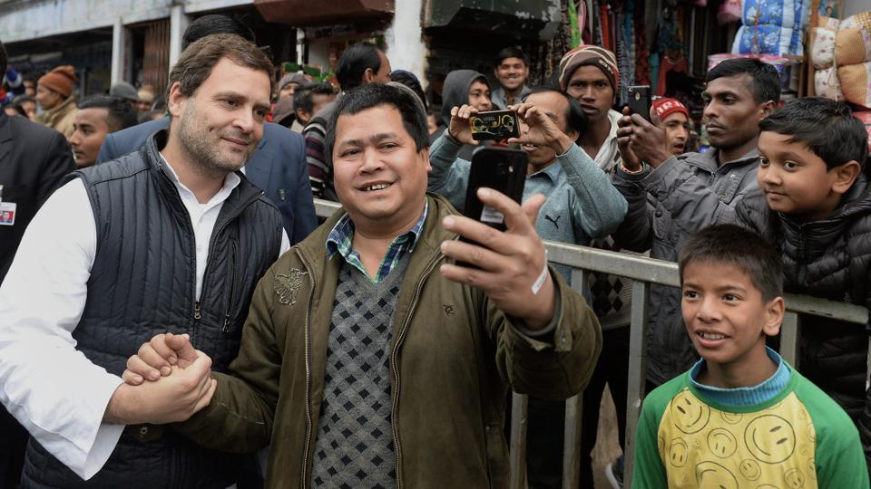 Congress president Rahul Gandhi poses for a selfie with a supporter during his visit to Jowai in West Jaintia Hills, Meghalaya, on Tuesday.