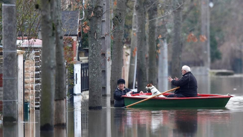 Residents on a small boat evacuate their house in a flooded street of Villeneuve-Saint-Georges, near Paris. The Meteo France weather service said January has seen nearly double the normal rainfall nationwide, and the rains in the past two months are the highest measured for the period in 50 years. (Christian Hartmann / REUTERS)